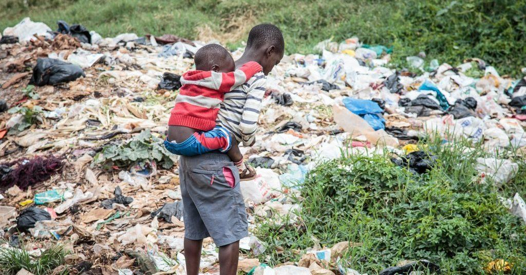 Kids searching a rubbish dump for food in Nairobi