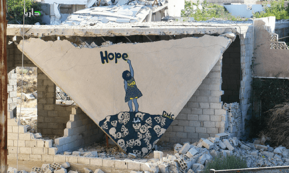 Abu Malik al-Shami's mural on a bombed out building in Damascus, Syria